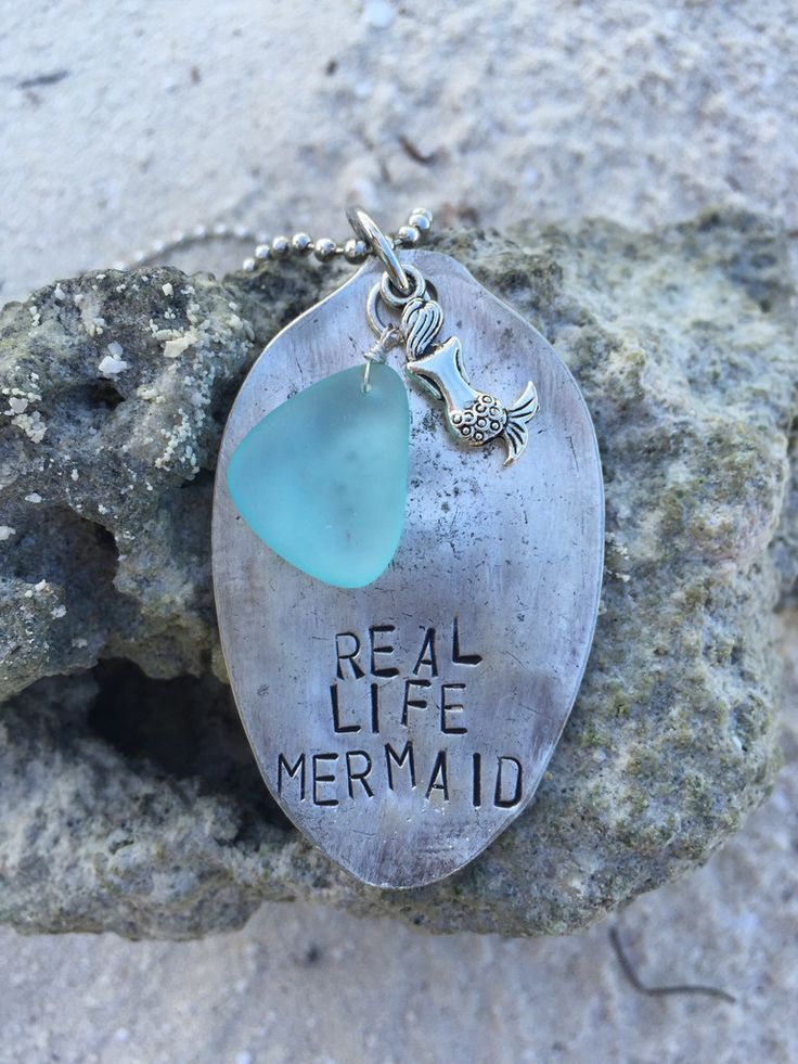 Darlin' it's better under the sea. Live the mermaid life with this vintage hand stamped spoon with a mermaid and sea glass charms. Choose your sea glass color from the drop down box. ~The item picture