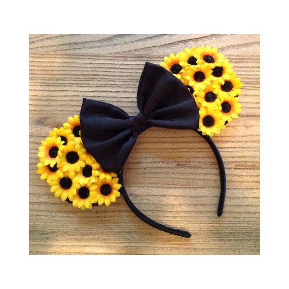Hand made sunflower mouse ears. The front of these ears are covered in artificial silk sunflowers. The back along with the bow is either a