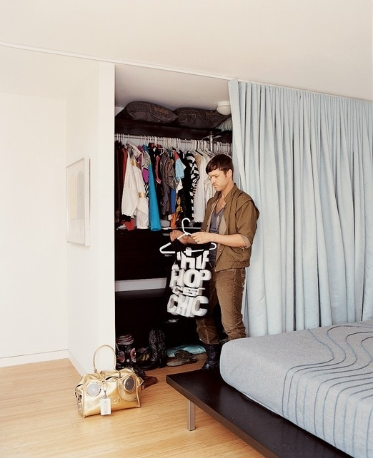 Curtain as closet door takes up much less space than swinging sliding