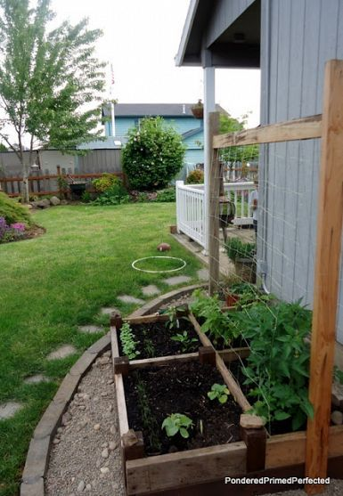 Old Bed Frame Repurposed as a Raised Garden Bed