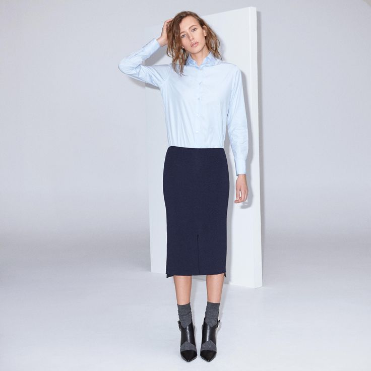 FWSS In Your Nature is a fitted pencil skirt in a knitted rayon fabric with slits on the front and back. Visible centre back silver zipper.