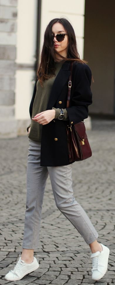 Beatrice Gutu is wearing a blazer from Marks & Spencer, army green cashmere sweater from DKNY, grey trousers from Zara, burgundy vintage bag and the shoes are from Mango