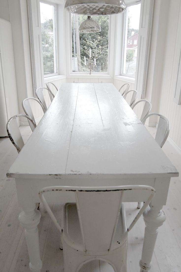 long white table with vintage white tolix chairs