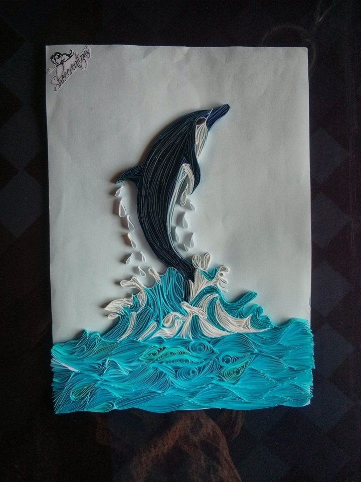 Quilled dolphin jumping out of water - by: Sheecreating