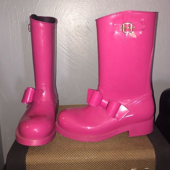 pink Valentino rain boots hot pink Valentino rain boots with gold accent latch and bow. all waterproof and super comfy. fits a 5-6. worn less than 5 times ever. Valentino Shoes Winter & Rain Boots