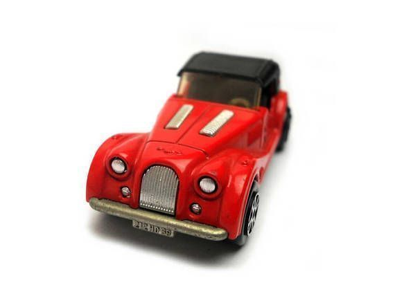 Vintage Majorette Morgan Sports Car Toy. red. black interior.1970s vintage toy & collectible made in France. Model Condition: very good. reduced price. rear bumper post missing. see rear vehicle image. Box: No Box. We only sell original diecast models, none of our items will have #vintagetoys