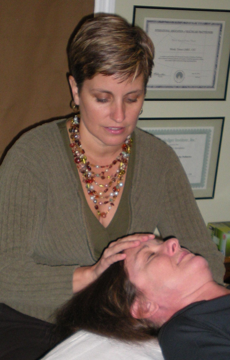 Sally Morgan demonstrating craniosacral therapy on Buster at The Conference  on Complementary Animal Healing.