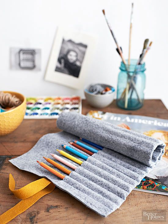 Practical for kids, pretty enough for adults, this felt pencil roll is easily customized. Step 1: To make one that holds 20 pencils, start with a 14x13-1/2- inch piece of felt. Fold the bottom edge over 1/2 inch and stitch. Fold the hemmed edge up to the inside to form a 14x8-1/2-inch roll; sew the sides using 1/2-inch seam allowances.  /