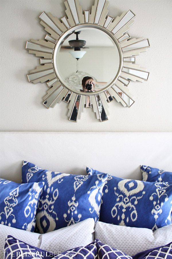 Master Bedroom Updates - Navy Blue Ikat Euro Pillows and Sunburst Mirror above the bed | The Blissful Bee