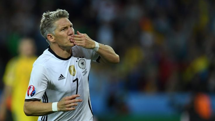 Bastian Schweinsteiger celebrates after sealing a 2-0 victory for Germany