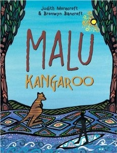 """This poignant story tells of how people first learned to surf through Malu Kangaroo, a kangaroo spirit, who carves a piece of wood and takes it to some children playing on a beach. He floats it on the water and shows them how to use it. The children learn to balance and guide the board through the waves """"riding the high crests"""" and """"flying before the crashing breakers."""""""