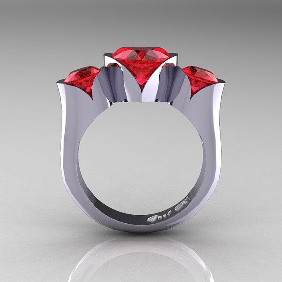 This nature classic floral ring has about 2.0 carat heart shape center stone and two 0.50 carat round side center stones for approx total of 3.0 carats.    This ring would make and excellent engagement ring or a very special present for your loved one.    Nature Classic 10K White Gold 2.0 Ct Heart Rubies Three Stone Floral Engagement Ring Wedding Ring R434-10KWGR    All finger sizes available at checkout, Also available in white gold, yellow gold, rose gold, black gold and platinum.    100%…
