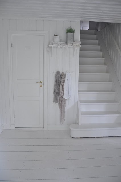 White stairs, floor and white everything in old Scandinavian home