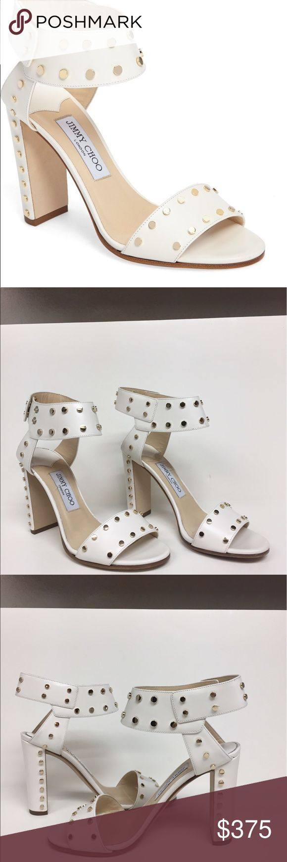 Jimmy Choo Veto 100 white stud rockstar sandals Clear linear lines are injected with personality in these gorgeous Jimmy Choo shoes. White leather with gold studs. Snap closure. Heel is 4 inches. Fabulous condition. All studs are there and perfect. Worn slightly on the bottom Jimmy Choo Shoes Sandals