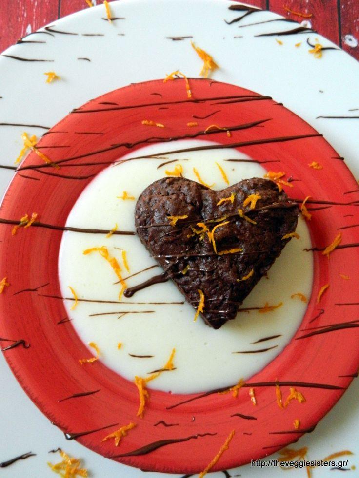Vegan chocolate brownies heart with orange cream