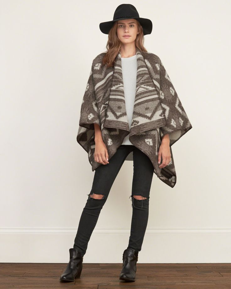 Introducing Woolrich, one of our favorite brands. Woolrich has been synonymous with quality outdoor clothing for over 180 years and is one of the original brands carried by Abercrombie & Fitch during its first years of business. This item was made in the US with the finest, hand-picked materials.<br><br>This blanket poncho is made from original Woolrich wool with all-over patterns, featuring an open silhouette.<br><br>Made in USA