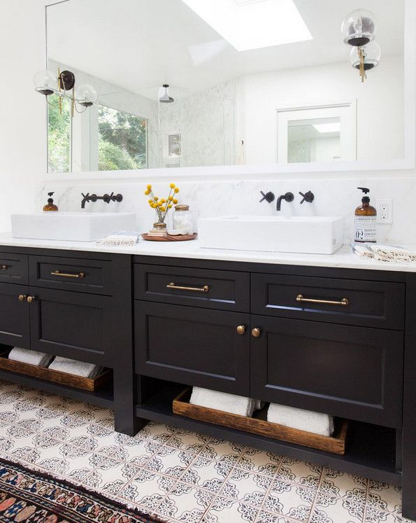 bathroom with navy double sink vanity topped with white counter and wall mounted faucets bathroom vanity and cement tiles