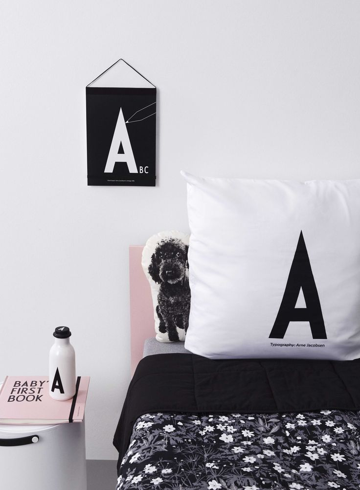 Stylish bedroom for kids. With Flowers by AJ bed cover, personal pillow case, colour book as wall decoration, personal water bottle, Baby's First Book and Stool & Storage as bedside table.