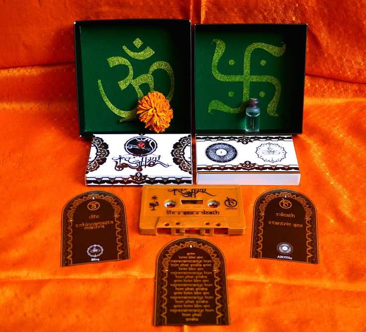 Cult Of Fire - Live,Sex and Death  MC Box.  MC edition made in collaboration with Triangulum Ignis. Limited to 300 copies, each of its boxes are handcrafted from scratch, printed in a traditional offset machine, and adorned with gifts from the Ganga river. Each offertory will consist of a Marigold flower recovered and gathered from the garlands worn by the dead, and water from the Sacred River in the cities of Mayapur and Varanasi