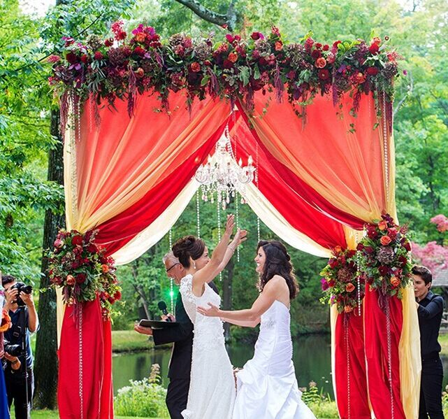 Draped with Colorful Fabrics - Unique Alternative Ideas for Decorating the Altar for a Wedding - EverAfterGuide