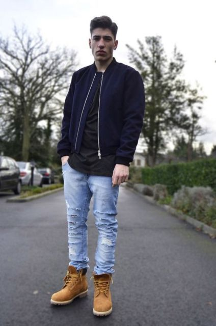 With distressed jeans, black shirt and jacket - Styleoholic