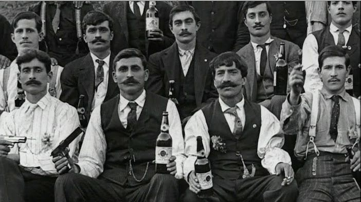 A group of Utah's Greek immigrants from Crete are seen with handguns and liquor. (Photo courtesy Utah State Historical Society)