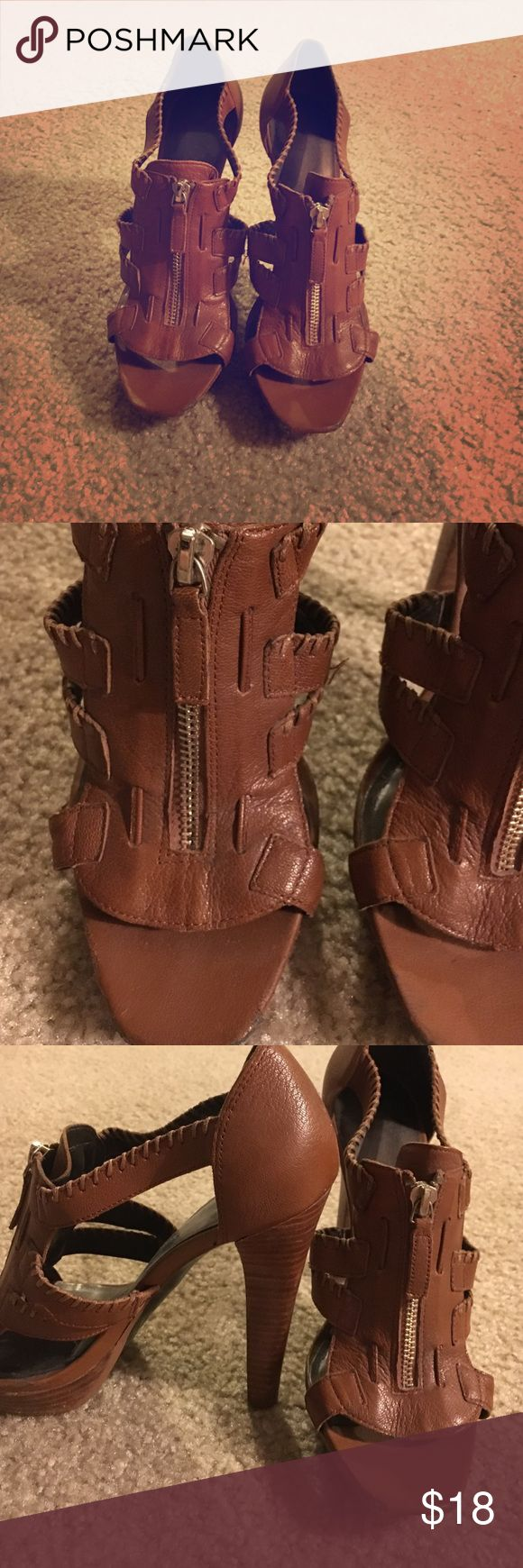 Jessica Simpson brown zip up heels Gorgeous shoe. The bottoms is where you will see wear, other then that they're still pretty shoes. Jessica Simpson Shoes Heels
