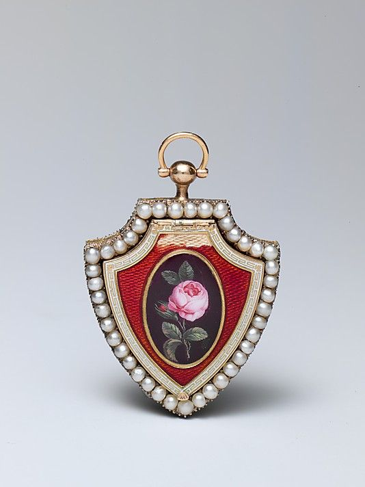 Music box. 1815. Switzerland. Gold and enamel shield-form pendant, one side with…