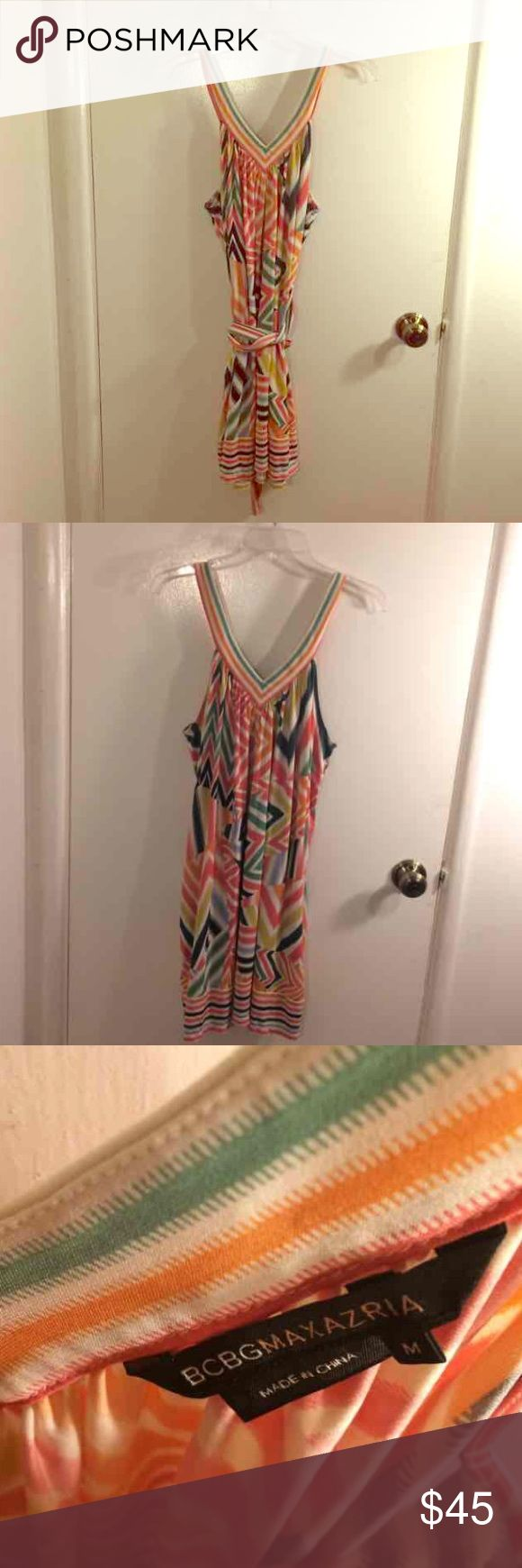 BCBG MAXAZRIA Striped Dress BCBG Maxazria women's size medium sleeveless green, orange, white, pink, and yellow striped v-neck knee length spring dress. Like new condition since it has never been worn. Matching waist tie included. Very on trend because stripes in unusual and new patterns is one of the main trends of spring 2017. Fabric content: 96% polyester 4% spandex. Very stretchy. BCBGMaxAzria Dresses Mini