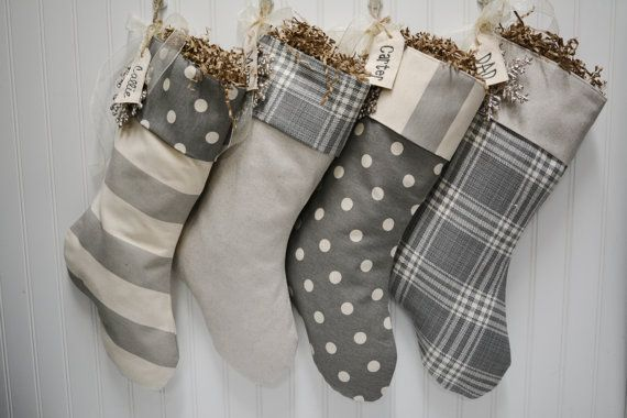 Set of 4 Christmas stockings in grey and white with embroidered name tags