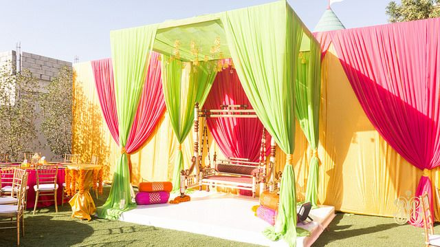 Canopies: Add a Touch of Color to Your Wedding Theme - If you are planning a theme for your wedding, a canopy can be a wonderful canvas on which to express it. This bright fuchsia, mint green and gold canopy proudly proclaims an Indian theme, creating a colorful and joyful aesthetic.