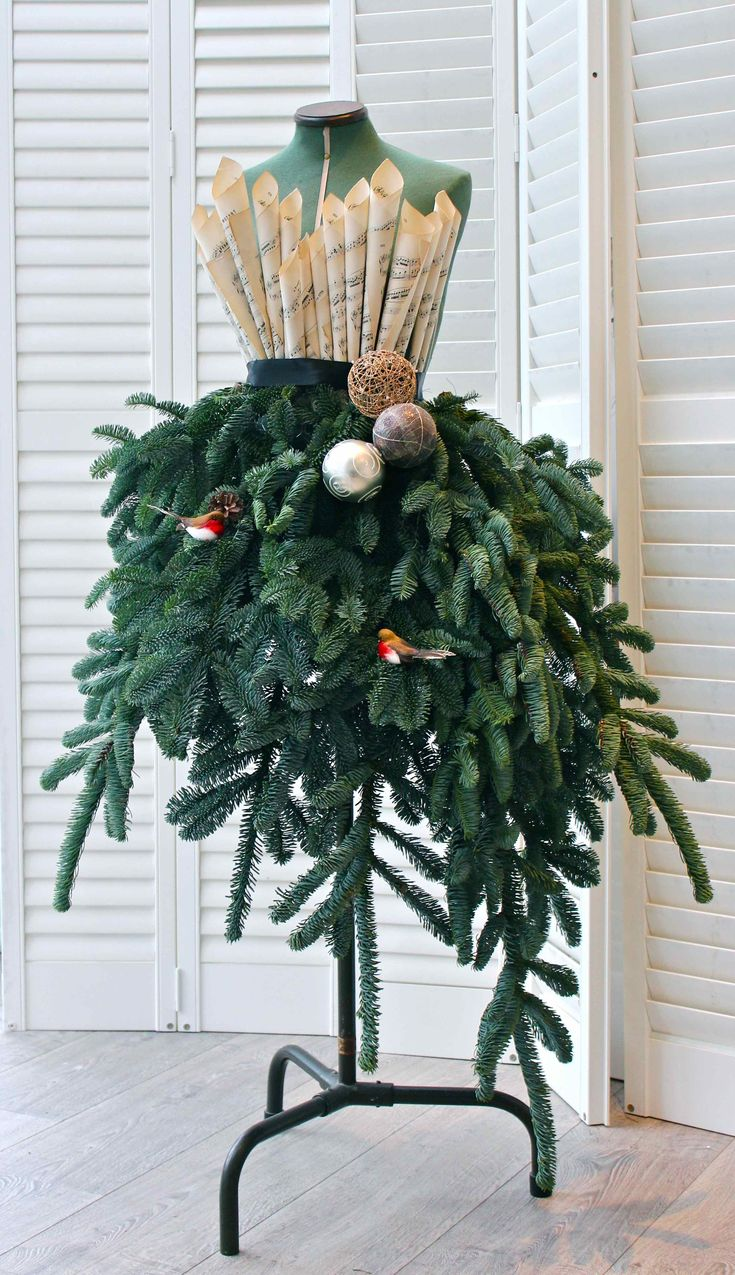 DIY Fir Dress for Christmas home decor by Kate of Kate's Creative Space. Imagine doing this for any season using season-appropriate greens, flowers, etc.