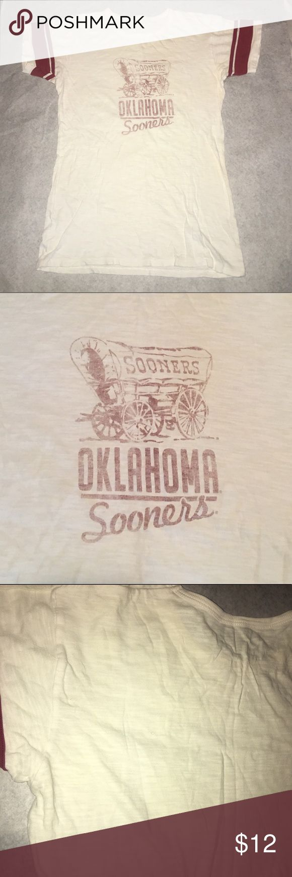Women's Oklahoma Sooner Tee Used - 1X. This was a Prank Shirt for my fiancé.  He's a UT  (University Of Texas) Fan.  There is a manufacture error in the back of the tee located in upper left hand corner.  It's a tiny small hole.  I didn't even notice the small hole when I purchased the tee.  Just now as I am inspecting the tee. Banner Tops Tees - Short Sleeve