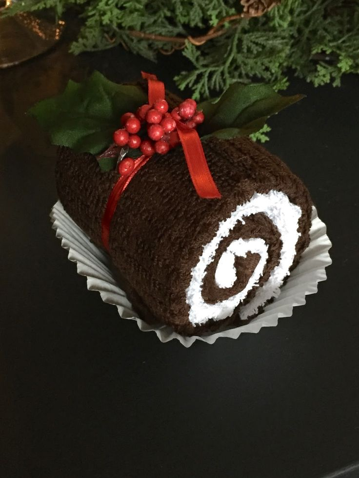 swiss roll gift idea made from hand towel and wash cloth