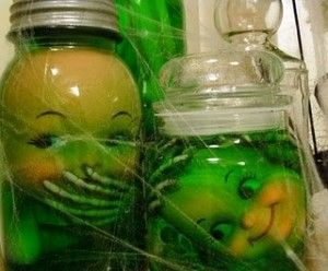Old doll heads & toy skeleton hands in jars filled with green water. Creepy Halloween party decor + don't forget to add a waterproof LED light to make it glow, EXTRA haunting OMG: http://www.flashingblinkylights.com/ledsubmersiblecraftlights-c-114_462.html