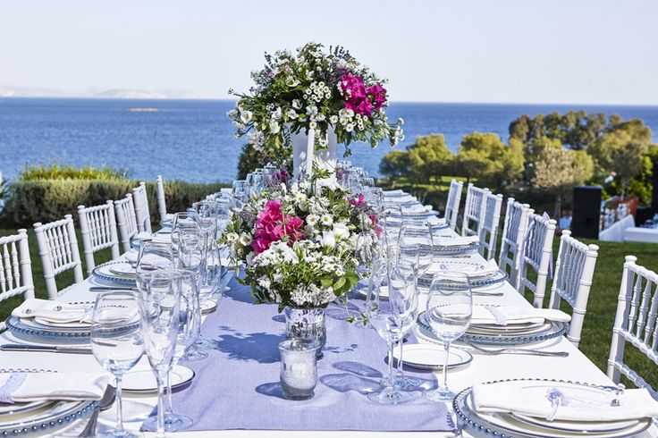 Mediterranean table setting in a magenda, lavender and white color palette inspired by the Greek island