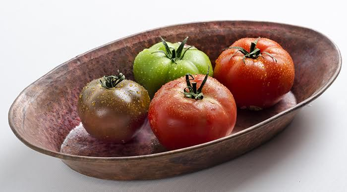 Even basic ingredients pop in our artisan serving dishes.