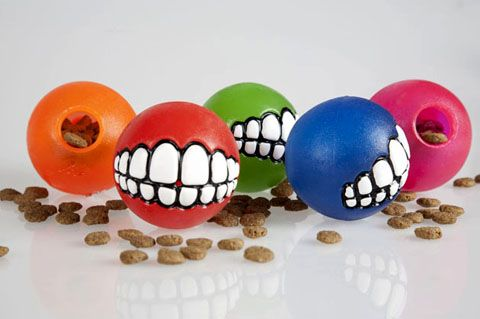 The Rogz Grinz Treat Ball is a funny and entertaining toy that your dog will love playing with, When your dog picks up this toy in its mouth it will look like it is grinning, Simply pop some delicious treats into the hole at the back of the ball and then watch the hilarity unfold!
