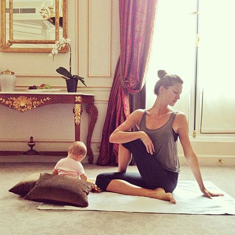 Gisele Bundchen practices yoga with her 6-month-old daughter Vivian Brady.