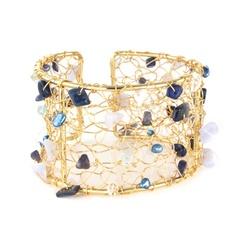 gold crochet cuff in shades on blue £27