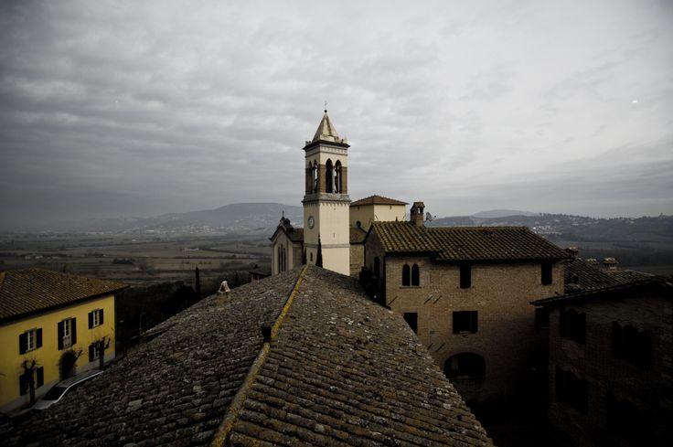 Brunello Cucinelli's village of Solomeo, with castle cum atelier headquarters below right of clocktower.