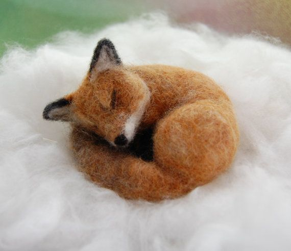 This poseable red fox is made using the needle felting technique over a wire armature. It measures 3.5 X 3 and nestles sweetly in the palm of your