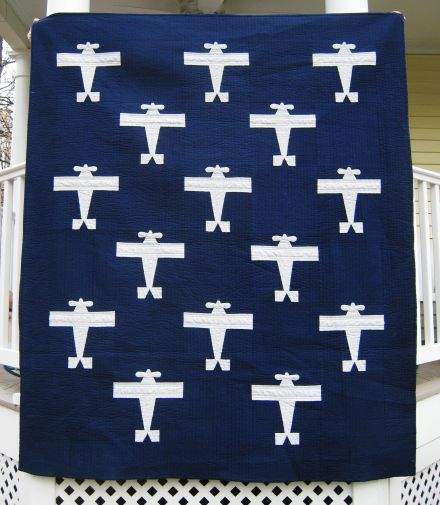"""Another nice example, by Corinne Sovey, of the 1929 Successful """"The Lone Eagle"""" pattern ... minus the quilted eagles and unusual with the white airplanes / colored background vs. the reverse."""