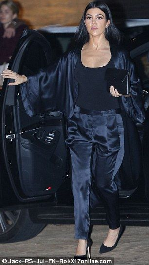 Kim Kardashian wears jacket with photos of her face printed across it
