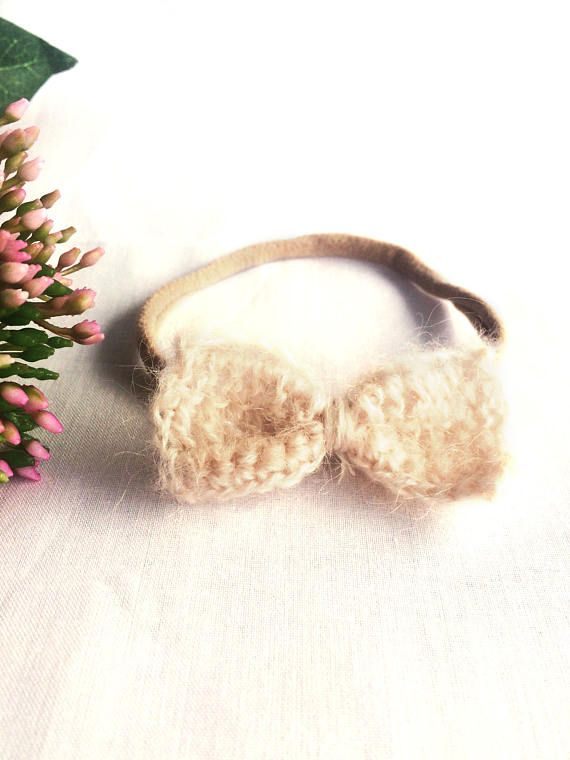 This delicate bow headband is a beautiful accessory for your Aussie boho babes all year round. The delicate pink/purple tone of these bows are all unique in specific tone due to the naturally occurring process of dying the yarn - meaning no two bows are the same. Each bow has been hand crocheted with 40% Acrylic, 30% Mohair and 30% Wool yarn. Paired with the soft and stretchy nylon headband, these bows will not leave marks on delicate baby skin.  These bows are approximately 5.5cm x 3cm ...