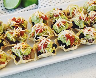 Created by: Ashley Torres, Pursuit of Shoes   Bite-size tacos? Count me in. With warmer temps and summer upon us, that means poolside barbecues, games of cornhole and taco bites for the win. This perfect snack for your weekend shindig has all the taco-meets-seven-layer-dip goodness in one little bite.