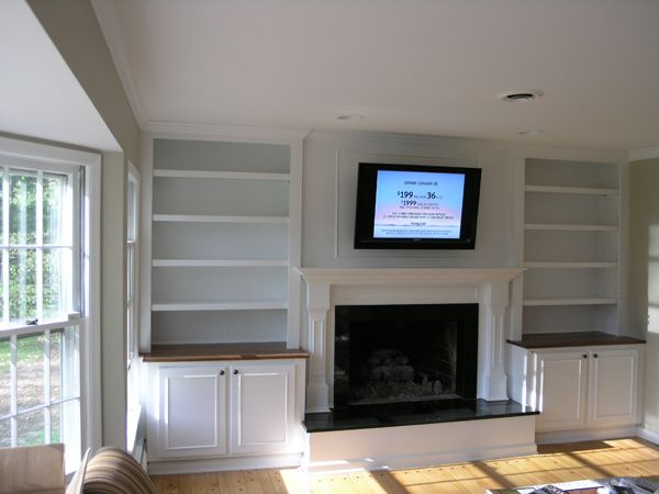 built in bookshelves around fireplace-except for picture frames, not books :)