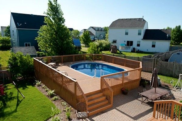 Large wood pool deck for oval pool in mchenry county built for Wooden pool