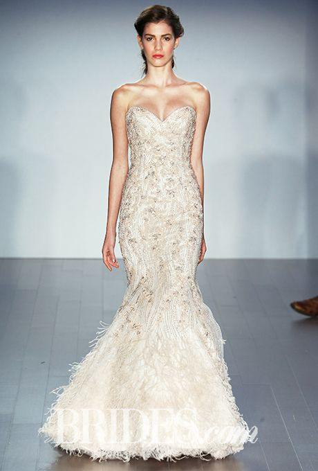 A flattering strapless @lazarobridal gown with a mermaid hem | Brides.com