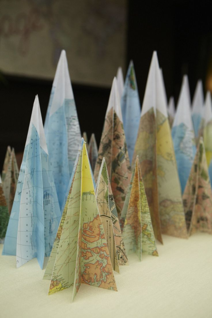Inexpensive and easy-to-find maps and map gift wrap were the perfect material for David Stark's paper mountain centerpiece seen on Martha Stewart Living.